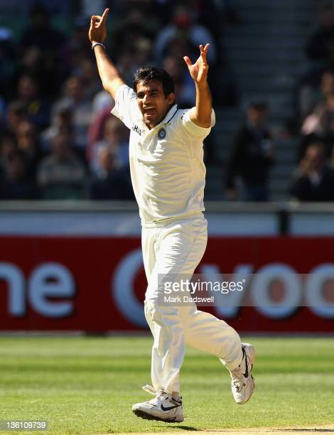 Zaheer Khan of India celebrates the dismissal of Mike Hussey of Australia caught by MS Dhoni during day one of the First Test match between Australia...