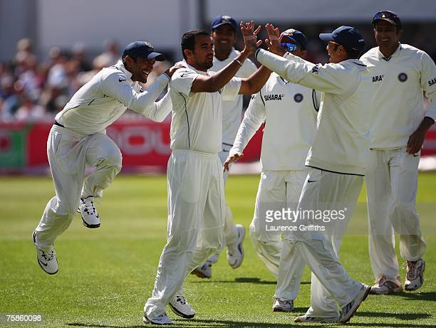 Zaheer Khan of India celebrates the wicket of Alastair Cook of England with team mates during day four of the Second Test match between England and...
