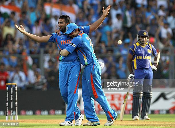 Zaheer Khan of India celebrates with team mate Virat Kohli after taking the wicket of Chamara Kapugedera of Sri Lanka with Mahela Jayawardene of Sri...