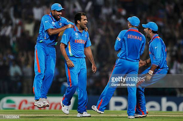 Zaheer Khan of India celebrates with team mates Yusuf Pathan and Yuvraj Singh after taking the wicket of Graeme Smith of South Africa during the...