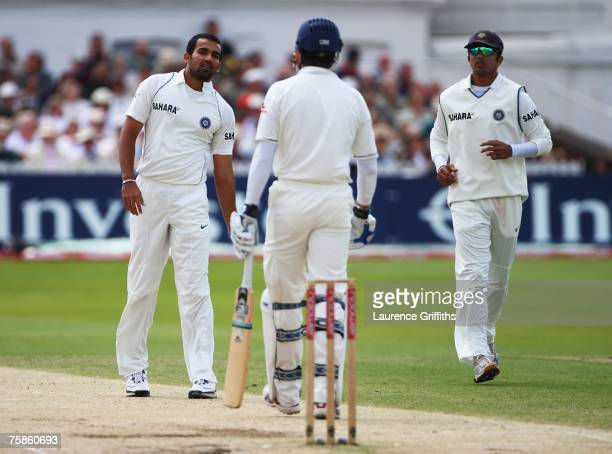 Zaheer Khan of India talks to Michael Vaughan of England as captain Rahul Dravid looks on during day four of the Second Test match between England...