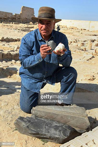 Zahi Hawass the head of Egypt's Supreme Council of Antiquities shows a bust believed to be of Cleopatra and a mask of Marc Anthony found at the...