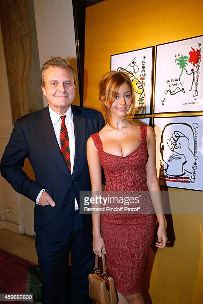 Zahia Dehar and Fashion designer JeanCharles de Castelbajac poses in front of Castelbajac's Christmas Tree during the 19th Edition of 'Les Sapins de...
