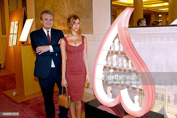 Zahia Dehar and Fashion designer JeanCharles de Castelbajac poses in front of Zahia's Christmas Tree during the 19th Edition of 'Les Sapins de Noel...