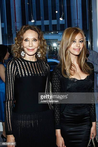 Zahia Dehar and Marisa Berenson attend the Jiang Shanqing Exhibition At La Galerie '12 Drouot on May 20 2014 in Paris France