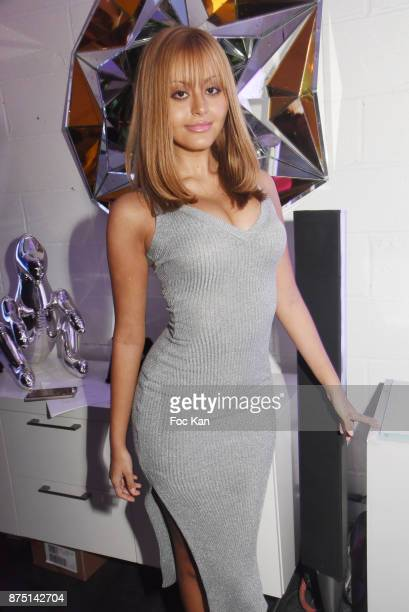 Zahia Dehar poses with a work of street artist Le Diamataire during the 'Second Life' By Le Diamantaire Private Exhibition Preview at Atelier...