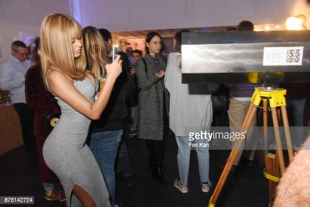 Zahia Dehar shoots a friend through the prism of a Le Diamantaire made 'Diamantoscope' during the 'Second Life' By Le Diamantaire Private Exhibition...