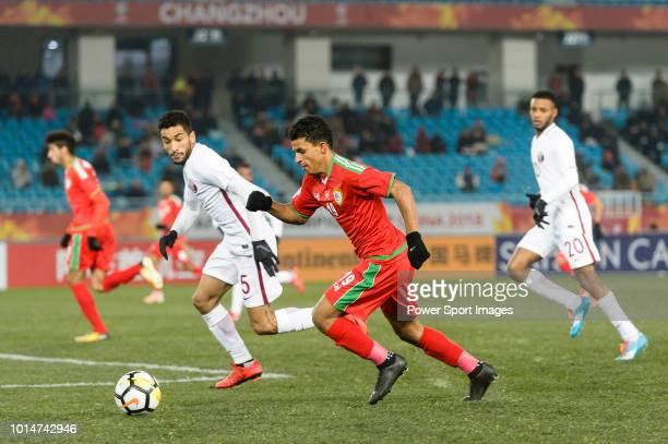 Zahir Al Aghbari of Oman in action against Tameem Al Muhaza of Qatar during the AFC U23 Championship China 2018 Group A match between Oman and Qatar...