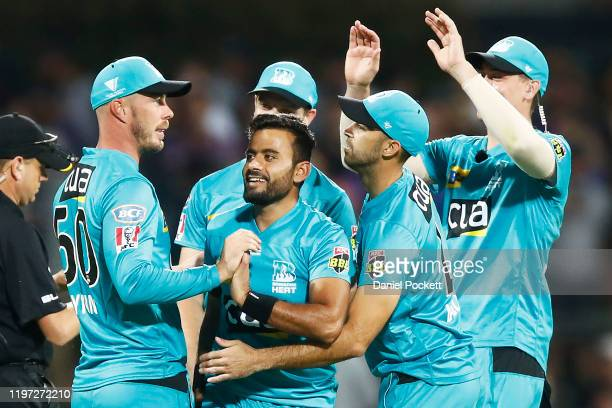 Zahir Khan of the Heat and Chris Lynn of the Heat celebrate after combining to dismiss Simon Milenko of the Hurricanes during the Big Bash League...