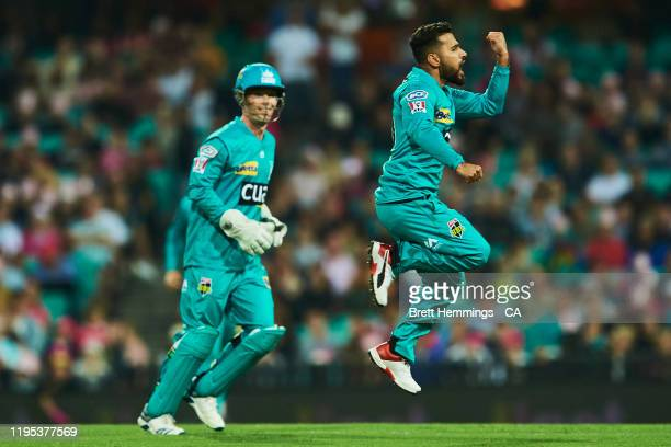 Zahir Khan of the Heat celebrates after taking the wicket of Josh Philippe of the Sixers during the Big Bash League match between the Sydney Sixers...