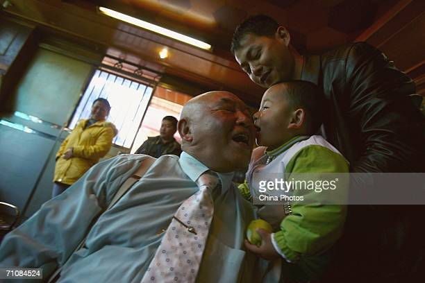 Zahkung Ting Ying leader of the New Democratic ArmyKachin kisses his grandson after the Kachin State Special Region 1 People's Conference on March 20...