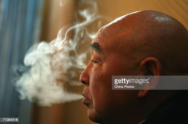 Zahkung Ting Ying leader of the New Democratic ArmyKachin smokes during an interview on March 15 2006 in Panwa Kachin State Special Region 1 of...