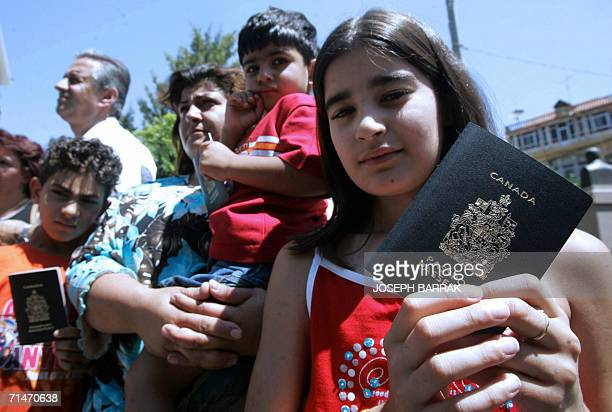 LebaneseCanadians hold their Canadian passports in front of alQaderi hotel in Zahle city in the Bekaa valley as Canadian nationals get ready for...