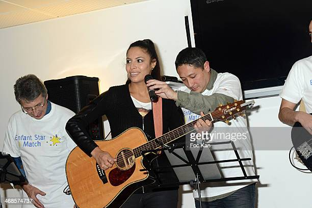 Zaho performs with a band during the 'Sourire Gagnant' Charity Event to Benefit 'Enfant Star Et Match' At Sporting Tennis Club on February 10 2014 in...