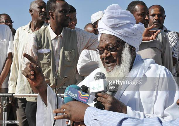 Zaid Mohammed Hamza the head a local Sudanese Islamist group leads prayers on May 3 in Khartoum in remembrance of the late AlQaeda mastermind Osama...