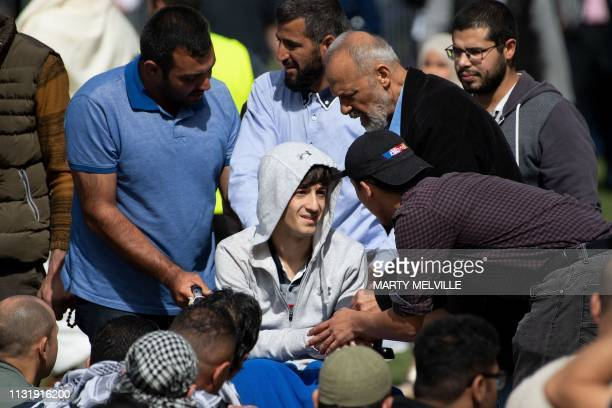 Zaid Mustafa who was wounded by an Australian white supremacist gunman in the twin mosque massacre arrives for congregational Friday prayers and a...