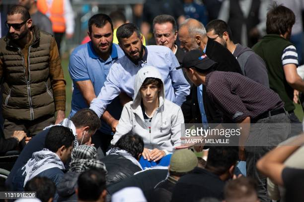 TOPSHOT Zaid Mustafa who was wounded by an Australian white supremacist gunman in the twin mosque massacre arrives for congregational Friday prayers...