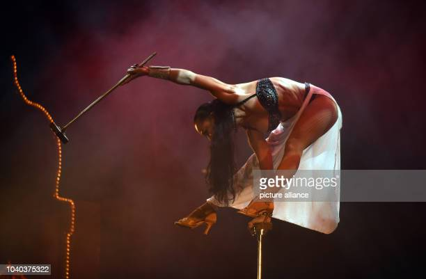 Zaida Liazeed of the acrobaticsduo 'The Liazeed' performs during the vaudevilleshow '1001 Nights in Marrakech' on stage of the Roncalli Apollo...