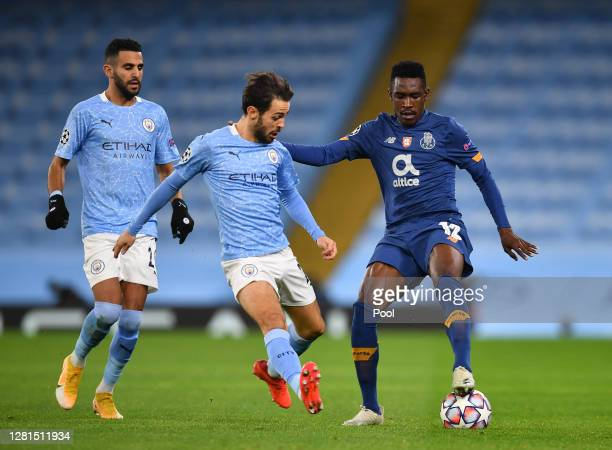 Zaidu of FC Porto is challenged by Riyad Mahrez and Bernardo Silva of Manchester City during the UEFA Champions League Group C stage match between...