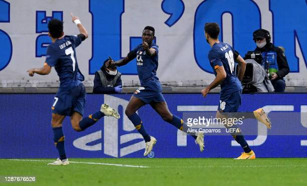 Zaidu Sanusi of FC Porto celebrates with Luis Diaz and Marko Grujic after scoring their team's first goal during the UEFA Champions League Group C...