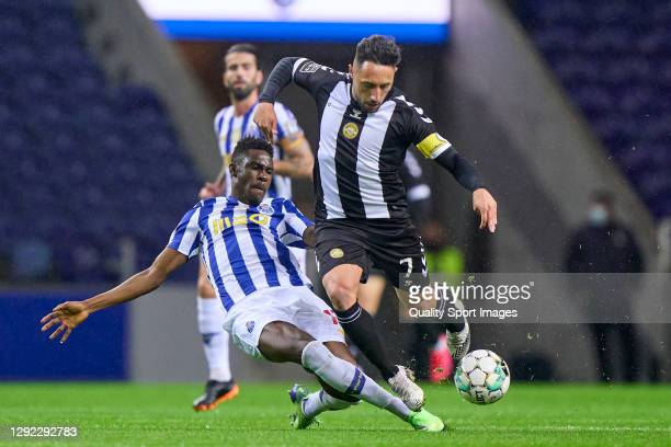 Zaidu Sanusi of FC Porto competes for the ball with Joao Camacho of CD Nacional Madeira during the Liga NOS match between FC Porto and CD Nacional at...