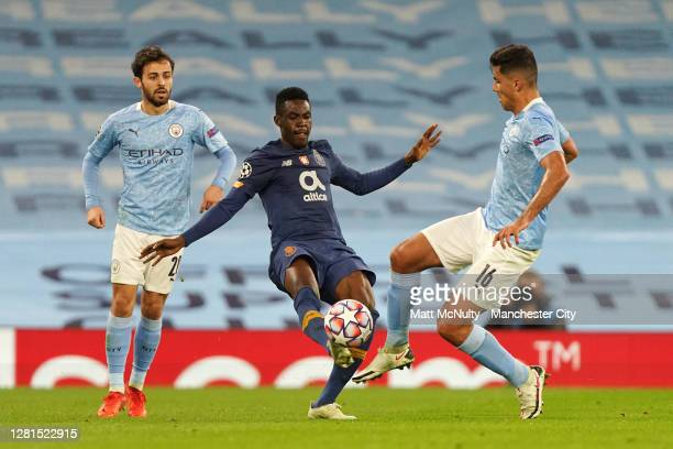Zaidu Sanusi of FC Porto is challenged by Rodrigo and Bernardo Silva of Manchester City during the UEFA Champions League Group C stage match between...