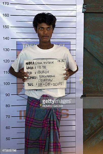 Zaik Husein a rescued Rohingya man from Myanmar is photographed during an Indonesian police identification process at the confinement area in the...