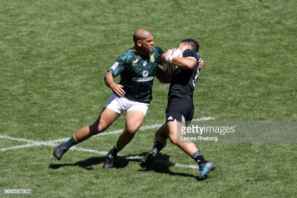 Zain Davids of South Africa and Tone Ng Shiu of New Zealand in action in their Cup Quarter Final match during the HSBC London Sevens at Twickenham...