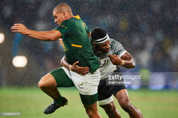 Zain Davids of South Africa is tackled by Vilimoni Botitu of Fiji during the 2020 Sydney Sevens Final match between Fiji and South Africa at Bankwest...