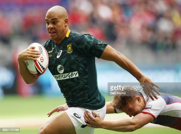 Zain Davids of South Africa runs the ball against Ivan Ovchinnikov of Russia during the Canada Sevens the Sixth round of the HSBC Sevens World Series...