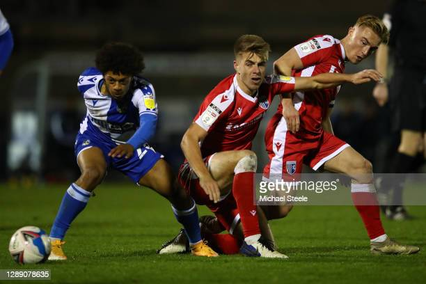 Zain Walker of Bristol Rovers turns as Jack Tucker and Kyle Dempsey of Gillingham challenge during the Sky Bet League One match between Bristol...