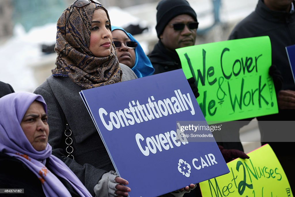 Zainab Chaudry (C) joins other supporters from The Council on American-Islamic Relations during a news conference outside the U.S. Supreme Court after the court heard oral arguments in EEOC v. Abercrombie & Fitch February 25, 2015 in Washington, DC. Samantha Elauf of Tulsa, Oklahoma, filed a charge of religious discrimination with the Equal Employment Opportunity Commission saying Abercrombie & Fitch violated discrimination laws in 2008 by declining to hire her because she wore a head scarf, a symbol of her Muslim faith.