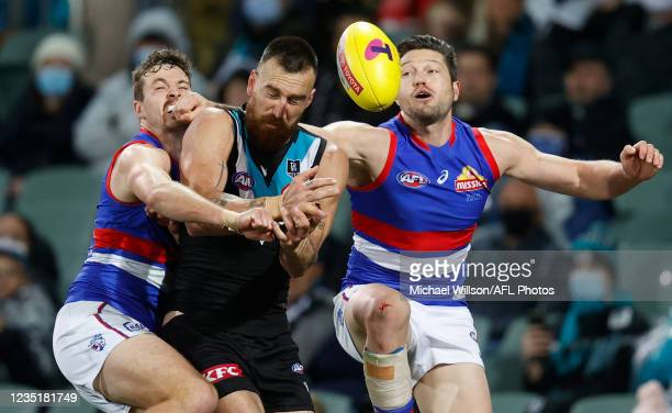 Zaine Cordy of the Bulldogs, Charlie Dixon of the Power and Stefan Martin of the Bulldogs in action during the 2021 AFL Second Preliminary Final...