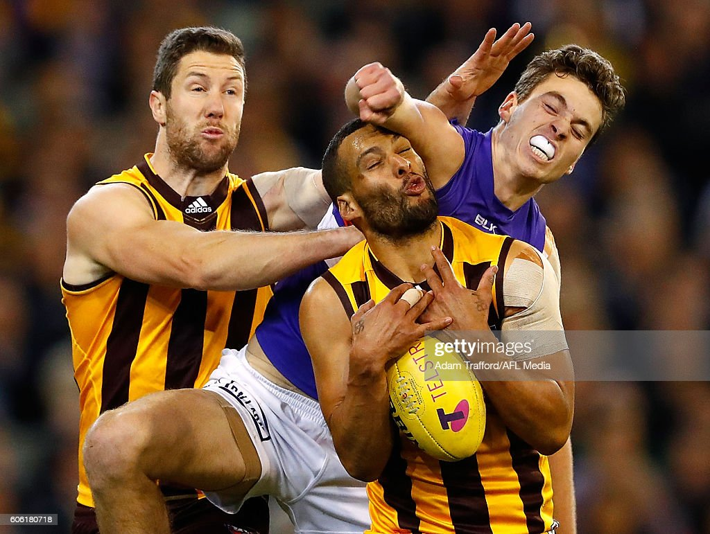 Zaine Cordy of the Bulldogs collides with James Frawley (left) and Josh Gibson of the Hawks during the 2016 AFL Second Semi Final match between the Hawthorn Hawks and the Western Bulldogs at the Melbourne Cricket Ground on September 16, 2016 in Melbourne, Australia.