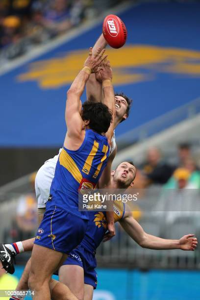 Zaine Cordy of the Bulldogs contests for a mark against Josh Kennedy and Daniel Venables of the Eagles during the round 18 AFL match between the West...