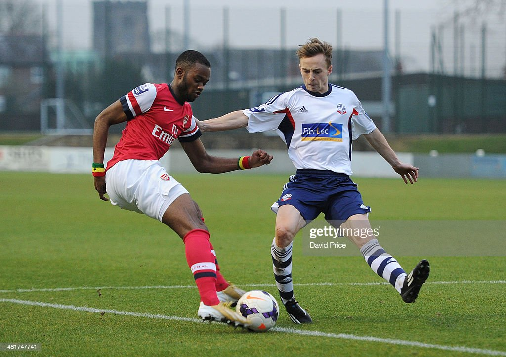 Zak Ansah of Arsenal cuts inside Andy Kellett of Bolton during the match between Bolton Wanderers U21 and Arsenal U21 in the Barclays Premier U21 League on March 31, 2014 in Lancaster, England.