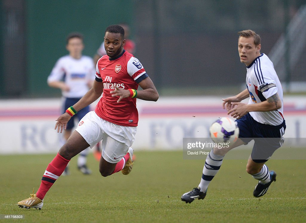 Zak Ansah of Arsenal spins past Oscar Threlkeld of Bolton during the match between Bolton Wanderers U21 and Arsenal U21 in the Barclays Premier U21 League on March 31, 2014 in Lancaster, England.