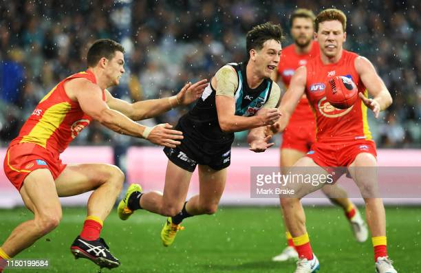 Zak Butters of Port Adelaide handballs during the round nine AFL match between the Port Adelaide Power and the Gold Coast Suns at Adelaide Oval on...