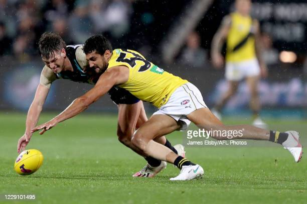 Zak Butters of the Power competes with Marlion Pickett of the Tigers during the 2020 AFL First Preliminary Final match between the Port Adelaide...