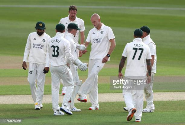 Zak Chappell of Nottinghamshire celebrates with team mates after taking the wicket of Durham opener Sean Dickson during Day 1 of the Bob Willis...