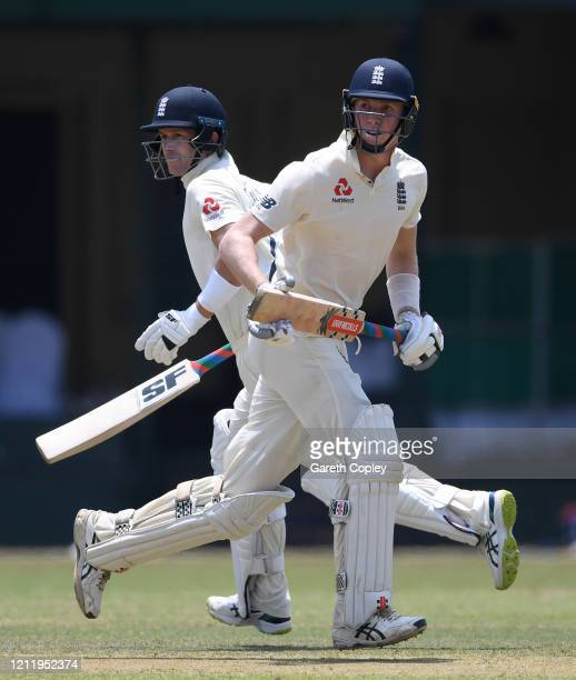 Zak Crawley and Joe Denly of England run between the wickets during the tour match between SLC Board President's XI and England at P Sara Oval on...