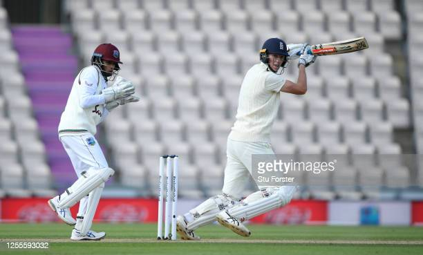 Zak Crawley of England bats watched by West Indies wicketkeeper Shane Dowrich during day four of the 1st #RaiseTheBat Test match at The Ageas Bowl on...