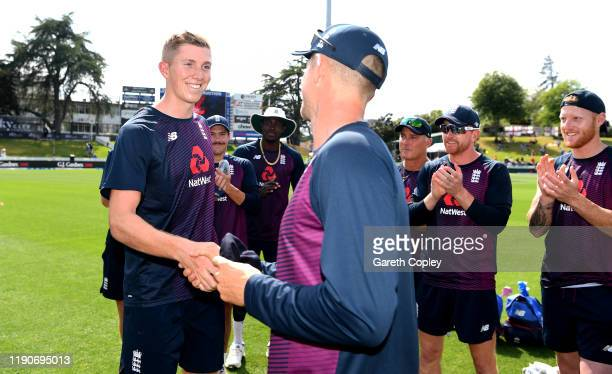 Zak Crawley of England is presented with his test cap by teammate Joe Denly ahead of day 1 of the second Test match between New Zealand and England...