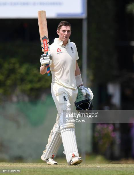 Zak Crawley of England salutes the crowds after reaching his century during the tour match between SLC Board President's XI and England at P Sara...