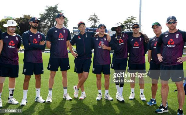 Zak Crawley of England waits with teammates to be presented with his test cap by Joe Denly ahead of day 1 of the second Test match between New...