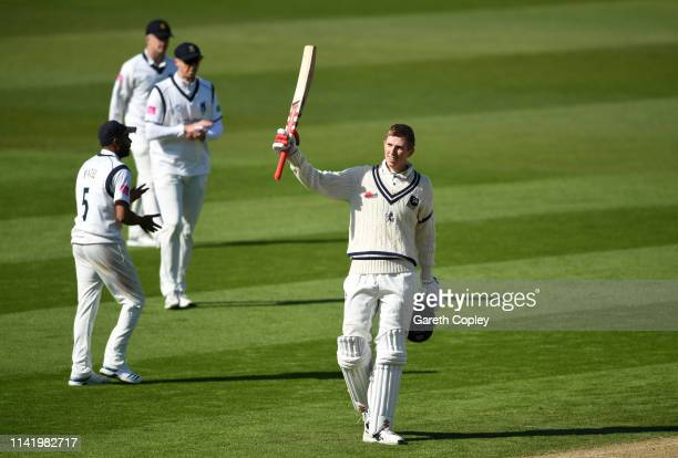 Zak Crawley of Kent celebrates reaching his century during the Specsavers County Championship Division One match between Warwickshire and Kent at...