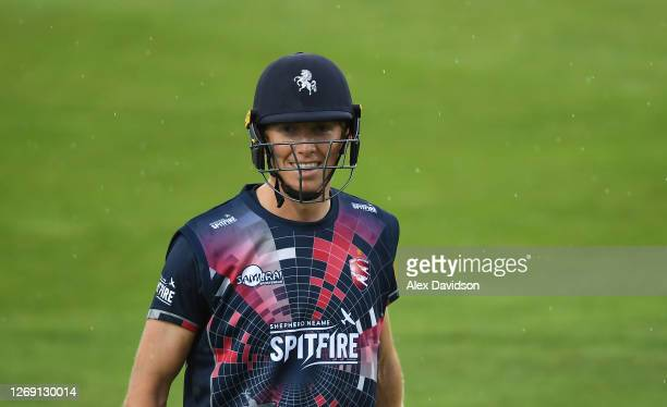 Zak Crawley of Kent walks off as rain delays play during the Vitality Blast T20 match between Kent Spitfires and Hampshire at The Spitfire Ground on...