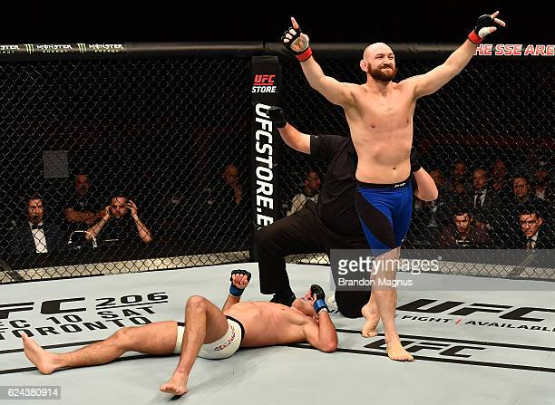 Zak Cummings celebrates his submission victory over Alexander Yakovlev of Russia in their welterweight bout during the UFC Fight Night at the SSE...