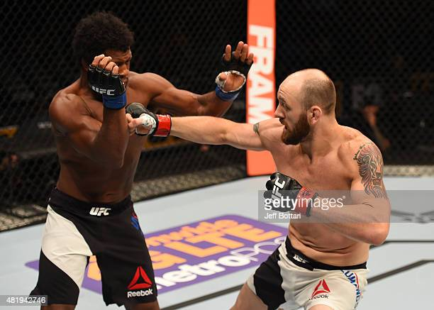 Zak Cummings punches Dominique Steele in their welterweight bout during the UFC event at the United Center on July 25, 2015 in Chicago, Illinois.