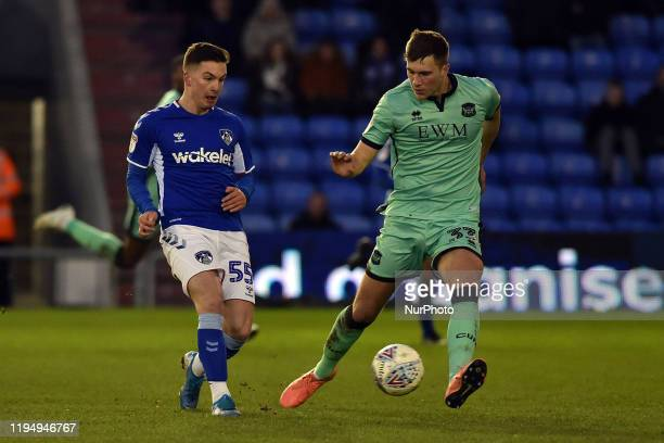 Zak Dearnley of Oldham Athletic and Max Hunt of Carlisle United during the Sky Bet League 2 match between Oldham Athletic and Carlisle United at...